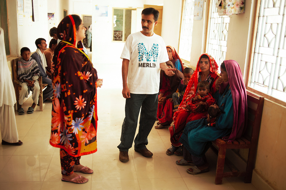 Doctor Hyder Shah talks with patients at the government helath facility in Bhu Khero, Dadu, Sindh, Pakistan on July 5, 2011.