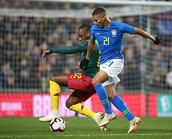 Brazil's Richarlison (right) and Cameron's Jean-Armel Kana-Biyik battle for the ball