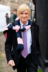 © Licensed to London News Pictures. 27/03/2019. London, UK. Michael Fabricant MP poses for a photo in College Green, Westminster after appearing on a television interview this morning. Later today MPs are expected to vote on a series of indicative votes on alternative proposals to British Prime Minister Theresa May's withdrawal agreement. Photo credit : Tom Nicholson/LNP