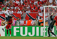 Photo: Glyn Thomas.<br />England v Trinidad & Tobago. Group B, FIFA World Cup 2006. 15/06/2006.<br /> England's Peter Crouch (L) scores his team's first goal.