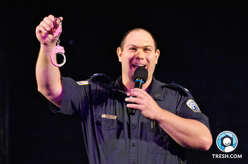 Sgt. Brett Parson, who is leaving his position as commander of the Washington Metropolitan Police Department's Gay & Lesbian Liaison Unit, unveils to the crowd at the Mr. Mid-Atlantic Leather Contest a pair of pink handcuffs, which he intends to use through his career as a symbol of his time with the unit.