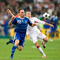 14 October 2008: French forward Franck Ribery #22 vies with Tunisian defender Yassine Mikary #18 during the friendly football match won 3-1 by France over Tunisia on October 14, 2008, at the Stade de France in Saint-Denis, near Paris, France.