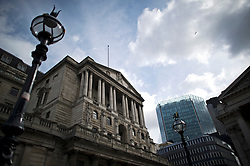 © London News Pictures. 01/07/2013. London, UK. General view of the Bank of England (left) in central London on July 01, 2013. The Bank of England is due to release the Money and Credit report for May. Photo credit: Ben Cawthra/LNP