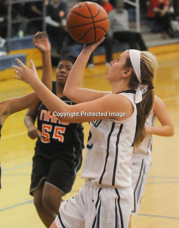 Hoggard's Julia Buehler shoots against New Hanover Friday December 12, 2014 at Hoggard High School in Wilmington, N.C. (Jason A. Frizzelle)