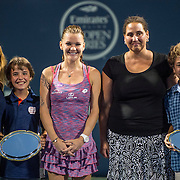 August 25, 2016, New Haven, Connecticut: <br /> Agnieszka Radwanska of Poland poses with winners of the family classic during Day 7 of the 2016 Connecticut Open at the Yale University Tennis Center on Thursday, August  25, 2016 in New Haven, Connecticut. <br /> (Photo by Billie Weiss/Connecticut Open)