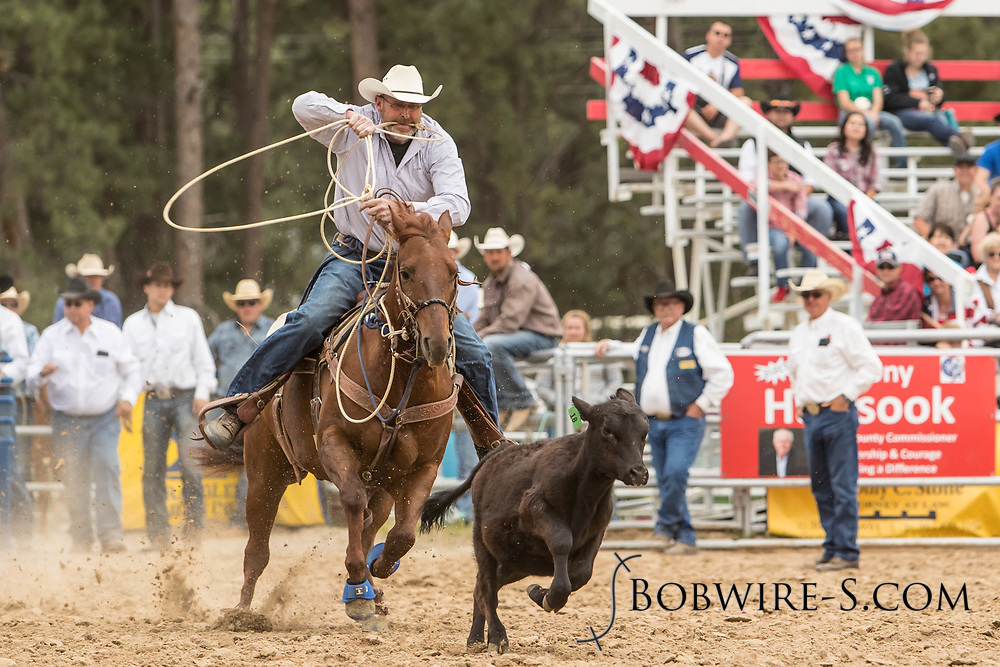 Troy Pruitt makes his tie-down roping run during the third performance of the Elizabeth Stampede on Sunday, June 3, 2018.