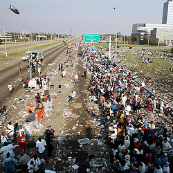 Thousands of people displaced by the hurricane waits to be taken to safety out of the area during a helicopter pickup at the Causeway on Interstate 10 during the aftermath of Hurricane Katrina Friday, September 2, 2005 in New Orleans, Louisiana.  <br /> (Pasadena Star-News Keith Birmingham)