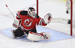 May 19, 2012; Newark, NJ, USA; New Jersey Devils goalie Martin Brodeur (30) makes a glove save during the first period in game three of the 2012 Eastern Conference Finals at the Prudential Center.