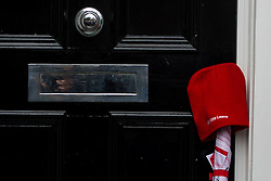 © Licensed to London News Pictures. 21/02/2016. London, UK. A 'Vote Leave' umbrella and hat left in the doorway of the home of Mayor of London Boris Johnson  after he returned to his London home. Boris Johnson is expected to announce today if he will campaign to leave or stay in the EU in a referendum in June. Photo credit: Ben Cawthra/LNP