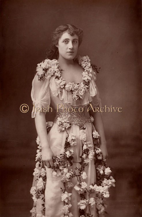 Julia Neilson (1868-1957) English actress. Played Drusilla Ives in the first production of 'The Dancing Girl' by Henry Arthur Jones at the Haymarket Theatre, London, (1891) and Hester Worsley in 'A Woman of No Importance' by Oscar Wilde (1893).  In 1891 she married the actor Fred Terry, brother of Ellen Terry.  From 'The Cabinet Portrait Gallery' (London, 1890-1894).  Woodburytype after photograph by W & D Downey.