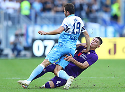 October 7, 2018 - Rome, Italy - SS Lazio v ACF Fiorentina - Serie A .Nikola Milenkovic of Fiorentina tackles on Senad Lulic of Lazio at Olimpico Stadium in Rome, Italy on October 7, 2018. (Credit Image: © Matteo Ciambelli/NurPhoto/ZUMA Press)