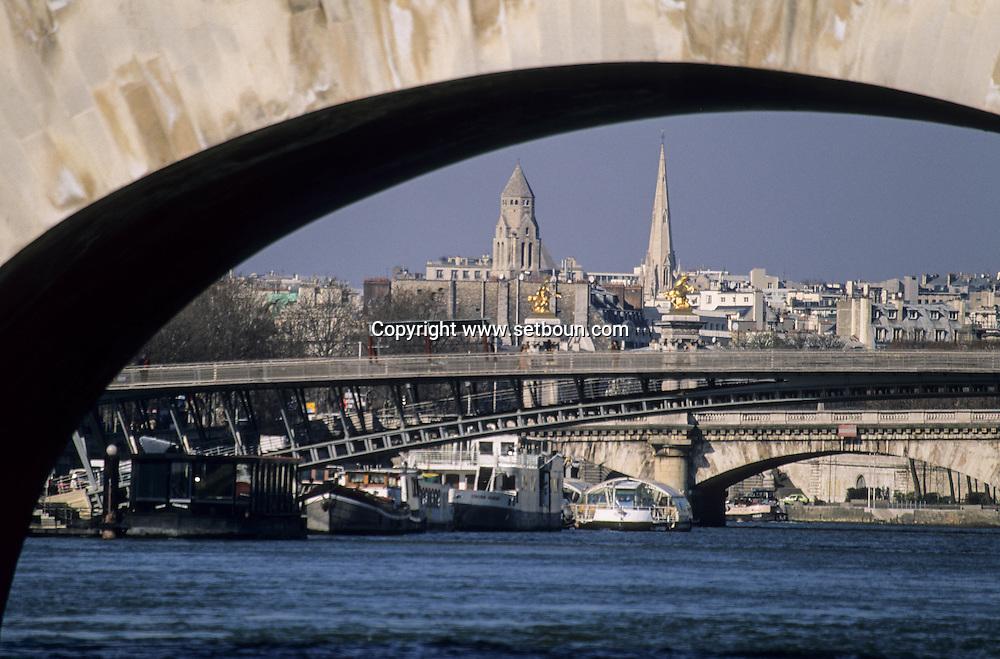 France. Paris. Seine river bridges. The Seine river bridges. quays .view from the boats - bateaux mouches-