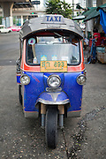 Sept. 23, 2009 -- BANGKOK, THAILAND: A tuk-tuk, or three wheeled taxi, in Khlong Toey Market. Tuk-tuks are common in the developing world because they are cheap to but and maintain. Khlong Toey Market is the largest market in Bangkok. Vendors sell everything from meat and fish to fruit and vegetables. They also sell clothes and dry goods in the market.   Photo by Jack Kurtz