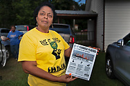 Sharon Lavinge founder of RISE St. James in front of the Mt. Triumph Baptist Church with a flyer about the proposed Formosa plant.