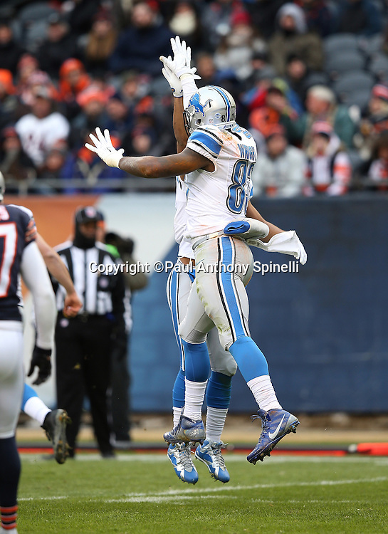 Detroit Lions tight end Timothy Wright (83) is leaps and celebrates after catching a 9 yard touchdown pass for a 7-0 first quarter Lions lead during the NFL week 17 regular season football game against the Chicago Bears on Sunday, Jan. 3, 2016 in Chicago. The Lions won the game 24-20. (©Paul Anthony Spinelli)