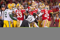 12 January 2013: NFL referee (23) Jerome Boger falls while trying to break up a scuffle between the San Francisco 49ers and the Green Bay Packers during the second half of the 49ers 45-31 victory over the Packers in an NFL Divisional Playoff Game at Candlestick Park in San Francisco, CA.