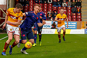 Jake Hastie of Motherwell wins the ball from Ben Garuccio of Hearts during the Ladbrokes Scottish Premiership match between Motherwell and Heart of Midlothian at Fir Park, Motherwell, Scotland on 17 February 2019.