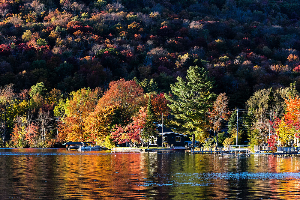 Autumn cottage on Caroga Lake, Caroga, Fulton County, New York, USA.