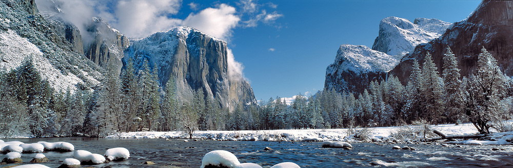 The Merced River, here dotted with snow-capped rocks, cuts through Yosemite National Park, California.