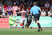 Scott Flinders blocks a Dominic Poleon shot during the EFL Sky Bet League 2 match between Cheltenham Town and Crawley Town at LCI Rail Stadium, Cheltenham, England on 4 August 2018. Picture by Antony Thompson.