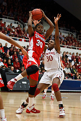 March 21, 2011; Stanford, CA, USA; St. John's Red Storm forward Centhya Hart (30) grabs a rebound in front of Stanford Cardinal forward Nnemkadi Ogwumike (30) during the first half of the second round of the 2011 NCAA women's basketball tournament at Maples Pavilion.
