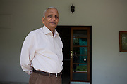 S.M. Khandelwal, the renown Agra businessman and former chairman of the Taj Trapezium Struggle Committee, is standing in the garden of his Agra home..