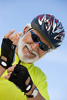 Portrait of Senior man adjusting cycling gloves