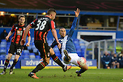 Birmingham City striker James Vaughan attempts to block Bournemouth defender Baily Cargill clearance during the The FA Cup third round match between Birmingham City and Bournemouth at St Andrews, Birmingham, England on 9 January 2016. Photo by Alan Franklin.