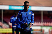 Koby Arthur of Macclesfield Town inspects the pitch while reading todays program during the EFL Sky Bet League 2 match between Crawley Town and Macclesfield Town at The People's Pension Stadium, Crawley, England on 23 February 2019.