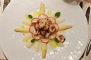Bad St. Leonhard, Carinthia, Austria. Trippolts Zum Bären gourmet restaurant.<br /> Zart gebratene Sepiolini, mit Zitronenspargel-Kohlrabisalat und Radieschen.