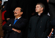 Picture by Mike  Griffiths/Focus Images Ltd +44 7766 223933<br /> 01/01/2014<br /> Vincent Tan and Ole Gunnar Solskjaer before the Barclays Premier League match at the Emirates Stadium, London.