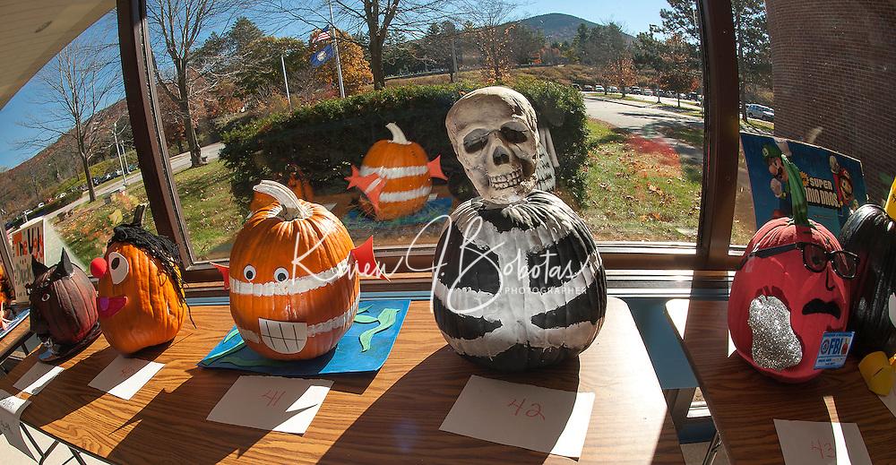 GHS decorates 48 pumpkins for contest.  (Karen Bobotas/for the Laconia Daily Sun)