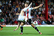 Nottingham Forest defender Matthew Mills (5)  fouling Brentford forward Scott Hogan (9) and is shown a yellow card, bookedduring the EFL Sky Bet Championship match between Brentford and Nottingham Forest at Griffin Park, London, England on 16 August 2016. Photo by Matthew Redman.