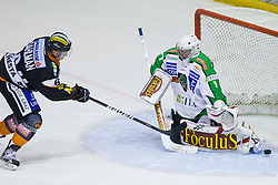 Toni Dahlman (Moser Medical Graz 99ers, #6) vs Jean-Philippe Lamoureux (HDD Tilia Olimpija, #1) during of ice-hockey match between Moser Medical Graz 99ers and HDD Tilia Olimpija in 11th Round of EBEL league, on October 14, 2011 at Eisstadion Graz-Liebenau, Graz, Austria. (Photo By Matic Klansek Velej / Sportida)