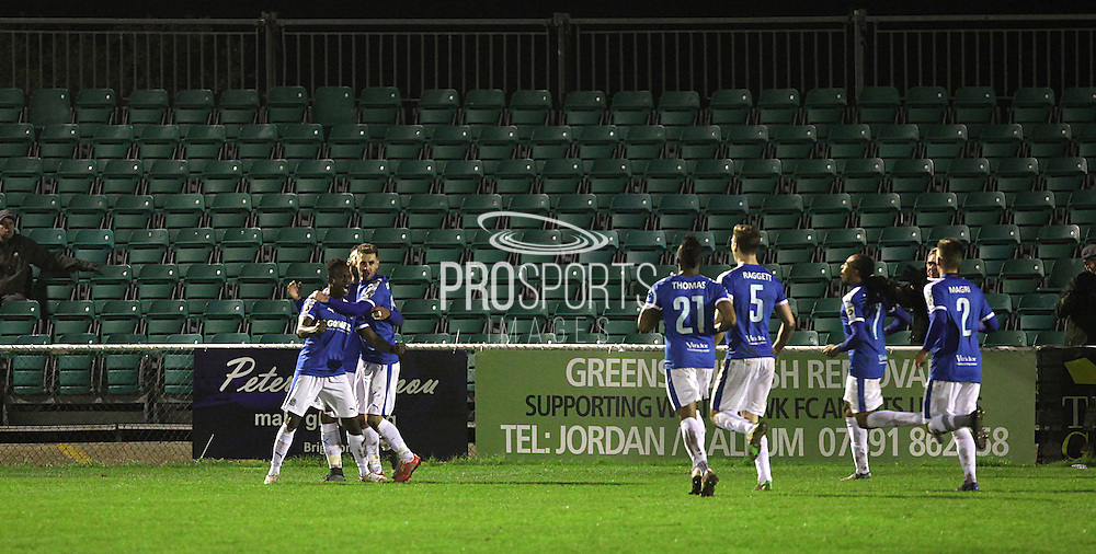 Toby Ajala receives the plaudits after Dover score their second goal during the FA Trophy match between Whitehawk FC and Dover Athletic at the Enclosed Ground, Whitehawk, United Kingdom on 12 December 2015. Photo by Bennett Dean.