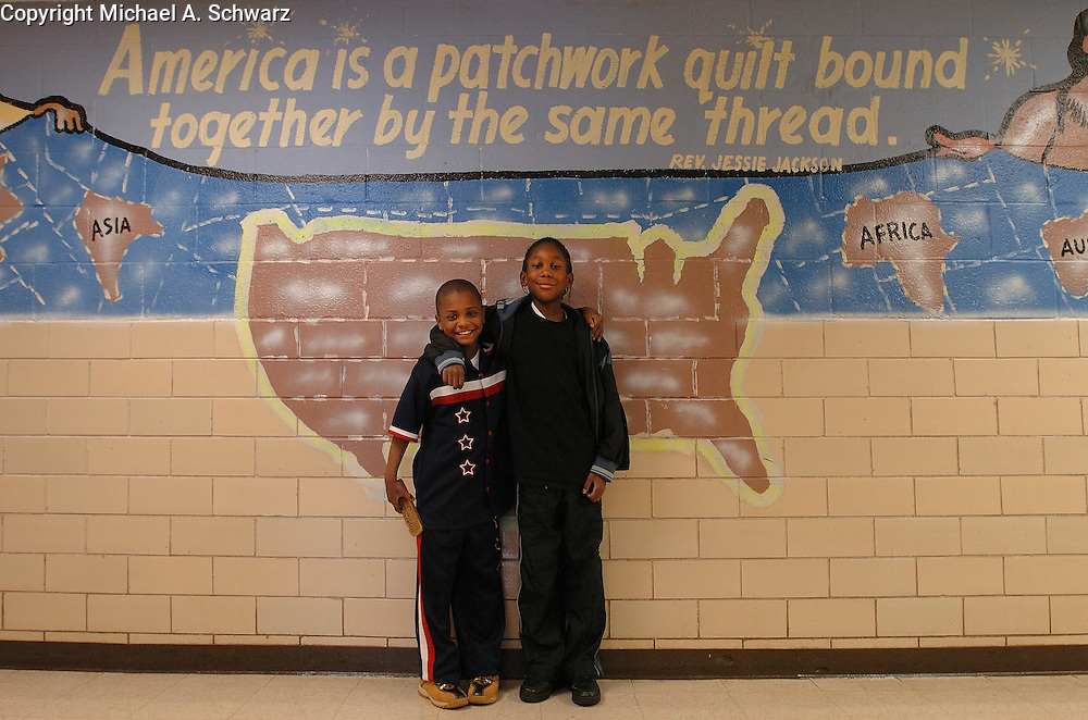 Decatur, GA.  April 14,2004.   Toney Elementary in Decatur, GA.<br /> Octavius Jordan 9, left and Ronnie Byrd,10 are friends from the same 4th grade class.  They were walking down the hall past a mural.