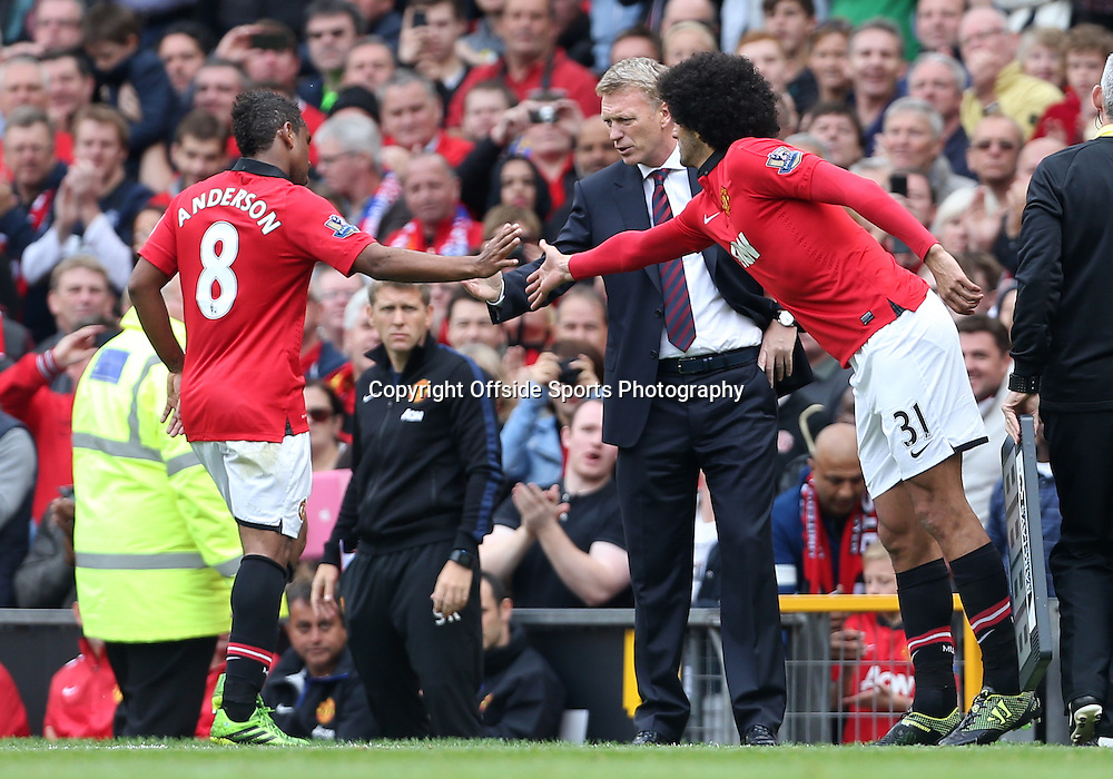 14th September 2013 - Barclays Premier League - Manchester United v Crystal Palace - Anderson of Man Utd shakes hands with Man Utd manager David Moyes (C) as Marouane Fellaini of Man Utd comes on to replace him - Photo: Simon Stacpoole / Offside.