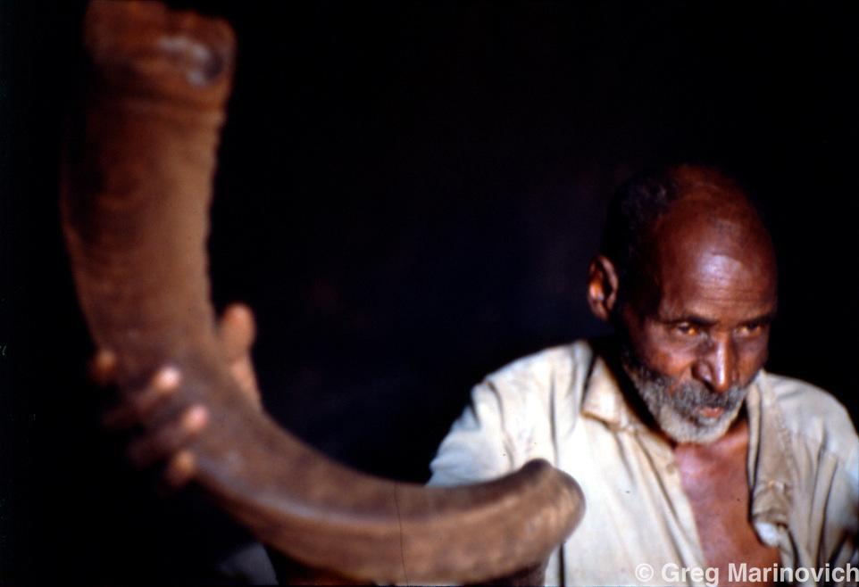 Official horn blower to summon people to Modjadji's ceremonies. Greg Marinovich 1988.