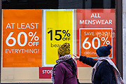 People walking past the sale signs outside the Folkestone Debenhams store in the final few days of the 'Everything Must Go' sale before closing down in Folkestone, Kent. United Kingdom. The company announced the closure of 19 stores across the UK after going into administration in 2019.  (photo by Andrew Aitchison / In pictures via Getty Images)