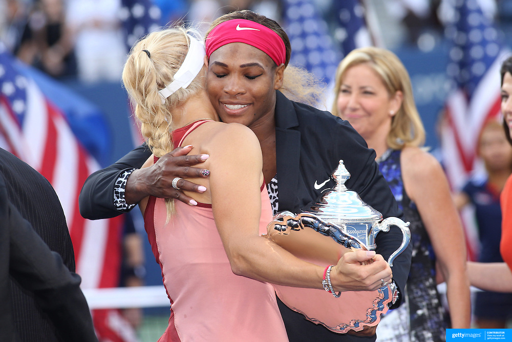 Serena Williams, USA, hugs Caroline Wozniacki, Denmark, iat the trophy presentation after the  Women's Singles Final during the US Open Tennis Tournament, Flushing, New York, USA. 7th September 2014. Photo Tim Clayton