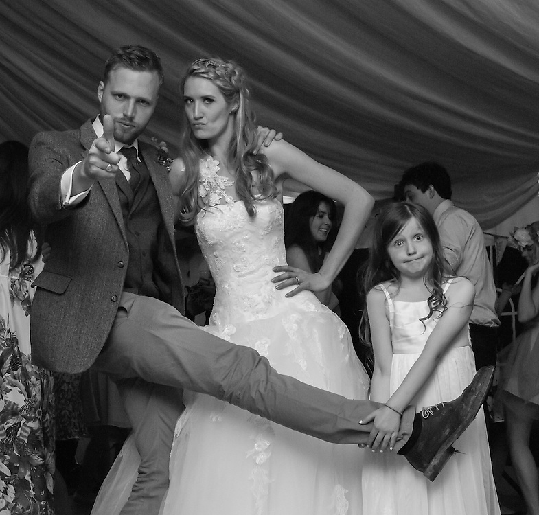 A shot of the best man and bride, I love this - the girl insictivlhy held the raised foot. A truly spontaneous portrait