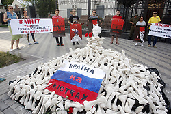 June 14, 2018 - Kiev, Ukraine - Ukrainian activists hold posters by artist Andrii Yermolenko during their protest demanding the boycott of the FIFA World Cup 2018 and the release of political prisoners held in Russia, in front of the Embassy of Russia in Kiev, Ukraine. (Credit Image: © Serg Glovny via ZUMA Wire)