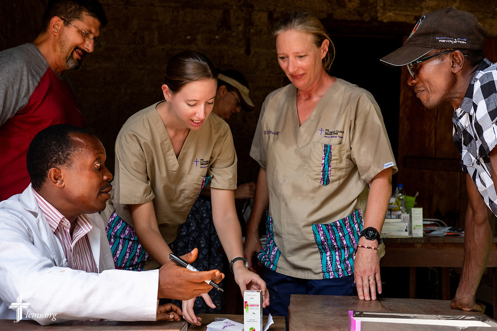 Francis Lahai, a pharmacist from Sierra Leone, works with LCMS Missionaries (L-R) the Rev. Doug Thompson, Molly Christensen, and Stephanie Schulte on the fourth day of the LCMS Mercy Medical Team on Thursday, May 10, 2018, in the Yardu village outside Koidu, Sierra Leone, West Africa. LCMS Communications/Erik M. Lunsford