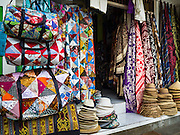 17 JULY 2016 - UBUD, BALI, INDONESIA: Shawls, hats and bags for sale in a tourist shop in Ubud, Bali.      PHOTO BY JACK KURTZ