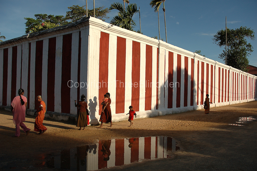 The Nallur Kandasamy festival in Jaffna, surrounded by a high red &amp; white wall. The annual festival is in July or August.<br /> Sri Lanka.