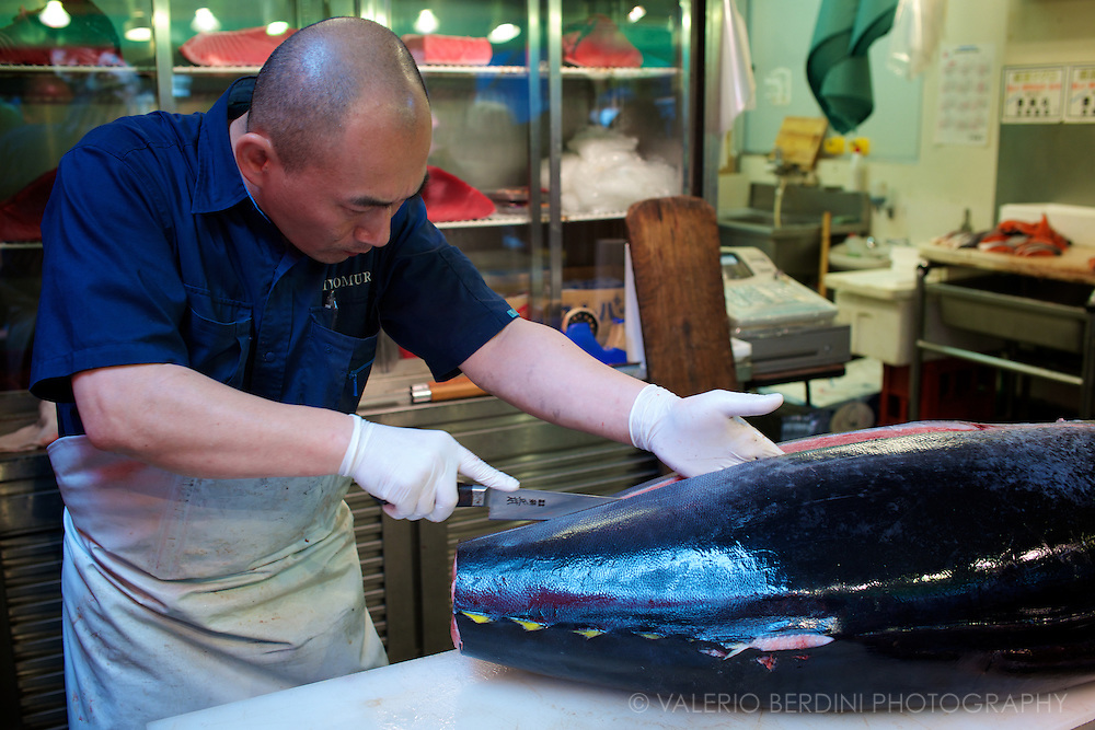 It requires a long time and different knives to get the cut sharp and neat. Tsukiji  Market. Tokyo, Japan 2013.
