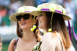 © Licensed to London News Pictures. 09/07/2018. London, UK. Spectators on the centre court during the Wimbledon Tennis Championships 2018, at the All England Lawn Tennis and Croquet Club. Photo credit: Ray Tang/LNP