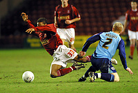 Photo: Dave Linney.<br />Walsall v Colchester United. Coca Cola League 1.<br />14/01/2006.<br />Walsall's Ishmel Demontagnac (L) is sent flying by Bobby Hassell.