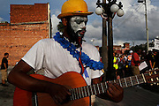 A protester named Daiquiri Renee Jones, with Occupy Tampa, plays the guitar during a march through the streets of Ybor City during the 2012 Republican National Convention on August 28, 2012.