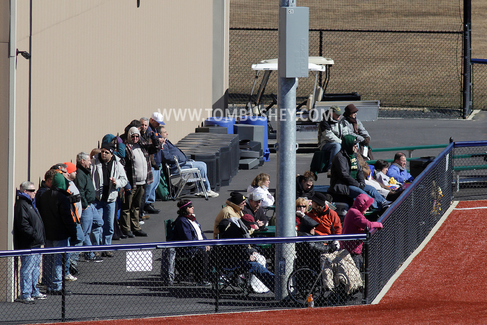 Chester, New York - Spectators bundled up for the cold watch Mount Saint Mary College play SUNY Brockport in a baseball game at The Rock Sports Park on Feb. 26, 2012.